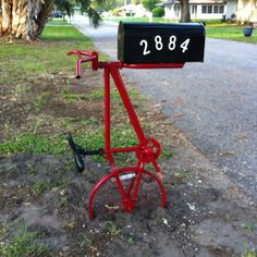 Our recycled bike mailbox post - my boyfriend's latest DIY project. I love it!