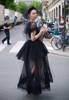 Ulyana Sergeenko in a lovely black dress and veil.