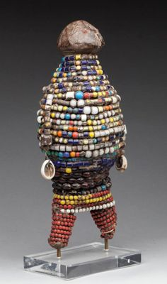 Africa | Fertility doll from the Namji people of Cameroon | Wood core, heavily decorated with glass beads and shells