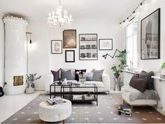 cozy swedish apartment with white wood floor_living room_cross rug