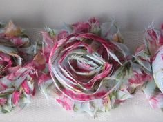 Check out this item in my Etsy shop https://www.etsy.com/listing/110645227/1-yard-shabby-fray-flowers-antique-pink
