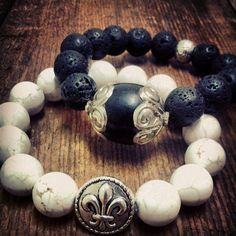 Single Strands range $30+  White turquoise with fleur-de-lis charm   lava stone with handmade focal bead from Nepal by Tibetan refugees. STEPHANIE LEIGH JEWELRY