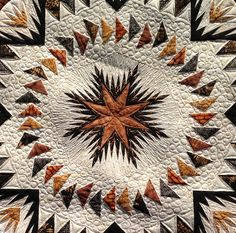 Mary's Glacier Star quilt.  Machine quilted by Kathleen Crabtree.