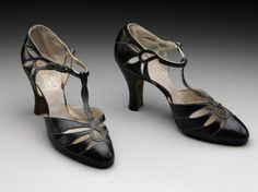Pair of woman's shoes American, early 1930s United States Dimensions length: 8 inches heel: 3 inches Medium or Technique Leather Classification Costumes Accession Number 2009.2362.1-2