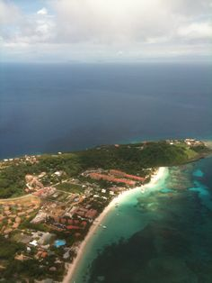 West Bay Beach, Roatan, Bay Islands, Honduras...here it's easier to see the amazing reef!!  Snorkeled where the white sand meets the rock near the top.