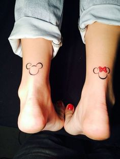 Mickey and Minnie Mouse tattoos on back of ankles