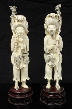 Pair of hand carved Japanese Ivory fisherman and fisherwoman figures.