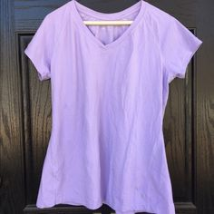 Danskin workout top Lilac short sleeve Danskin workout top in good used condition with no rips or stains. Very soft, stretchy and sweat wicking. 95% cotton 5% spandex. Length is 25 inches long and underarm to underarm measures 20 inches across. Thanks for looking. Danskin Tops Tees - Short Sleeve