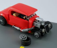 https://flic.kr/p/sN9nTN | Red hot rod - Front wheel assembly | In order to have the look of the Speed Champions rear wheels for the smaller front wheels I had to figure out a way to make the wheel cover part work with the smaller tires. Using the black wheel for the rear was part of the strategy of getting exactly the same look as well.