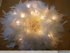 Krans witte veren met led verlichting - Te koop
