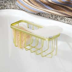 Attach a pretty gold suction cup basket to help your sponge dry and keep that funky sponge smell at bay.