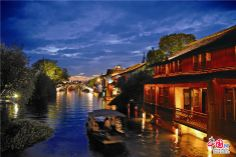 With a history of 1,200-years, Wuzhen is about one hour's drive from Hangzhou, the capital of Zhejiang province. The small town is famous for the ancient buildings and old town layout, where bridges of all sizes cross the streams winding through the town