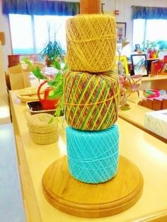 montessori workjobs: sewing in the montessori primary classroom - paper towel holder for holding string