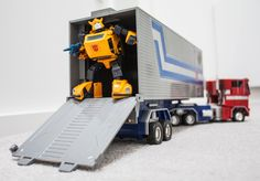 Transformers Masterpiece MP-21 Bumble (Bumblebee) with 20th Anniversary (Masterpiece) Optimus Prime and JustiToys trailer