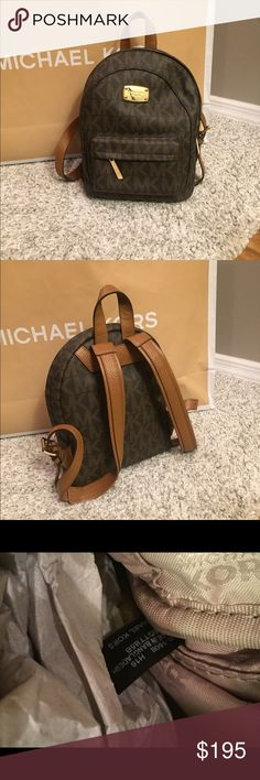 """Michael Kors Jet Set Backpack  ⭐️NWT MK Jet Set Signature Small BackpackColor:  BrownGold Tone HardwareMK Signature Coated Canvas with Leather TrimZip around ClosureExterior zip pocketInterior zip pocket and 4 slip pocketsMK Signature Soft Fabric Interior LiningAdjustable double shoulder strap and top tabApproximate Measurement: 10.5"""" (L) x 8"""" (H) x 3.5"""" (D)NO TRADESCan do less on Ⓜ️ Michael Kors Bags Backpacks"""