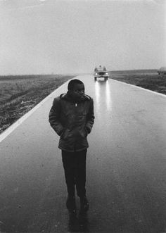 Young hitchhiker on highway near Chicago, IL, c. 1950s Lee Balterman