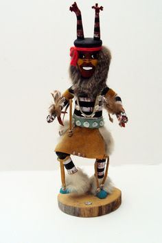 This genuine Navajo Kachina Watermelon doll is hand made by Native Americans of Navajo Nation in New Mexico. The doll is made of wood, fur,