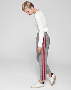 Combining expert tailoring with contemporary design, these checked trousers will instantly lift an outfit. The monochrome Prince of Wales check, a key trend for this season, is updated with sporty side stripes in vibrant red #womentrousers