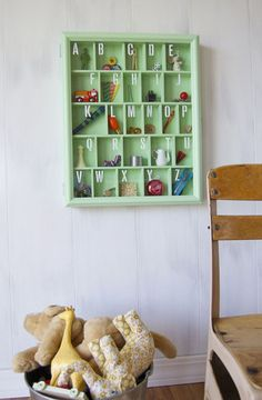 What a cool DIY shadowbox!  For a child, you can use toys and simple items. For an adult, just imagine how creative or artistic you could get. I'm imagining a black frame and black dividers with a white backdrop, and putting amazing primary-colored or silver alphabetical objets d'art inside.