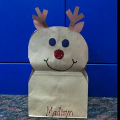 Reindeer made from brown paper bag.