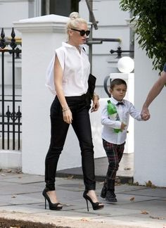 gwen stefani is the hottest celeb mom out there.. she inspires me!  I wanna wear red lipstick every day!!!!