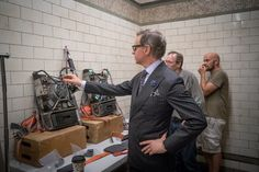 Director Paul Feig and prop master Kirk Corwin (center) examine the new proton packs.