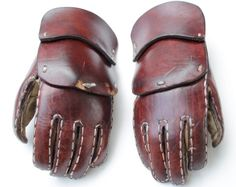Reinforced gloves / fingered leather gauntlets. Would be somewhat clumsy to grasp things, but less than mittens, I think.