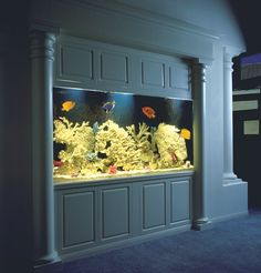 300 Gallon Aquarium with White Lacquered Wood Finish. The wood working turned out great! Built in Beverly Hills, California.
