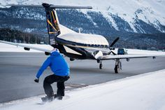 Britain's fastest snowboarder reaches speeds of as the first person in the world to be towed by a commercial plane. Jamie Barrow, who is on the British Snowboard Cross Team, completed a death-defying stunt in the Swiss resort of St Moritz Commercial Plane, Commercial Aircraft, Princess Tower, Swiss Ski, Go Skiing, Ski Holidays, Base Jumping, Travel News, World Records