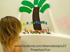 Dinosaur bath time.  Foam coconut tree, foam letters, dollar tree plastic dinosaurs!  FUN!