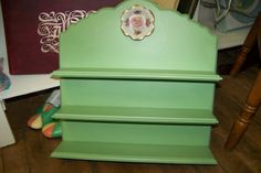 Shelf painted green and a cute little floral plate and rose glued to the top