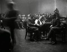 John Dillinger handcuffed to Deputy Sheriff R.M. Pierce during Dillinger's murder trial hearing in Crown Point, Ind. His trial was scheduled for March 12, 1934, but Dillinger escaped from Crown Point prison on March 3rd, and carried out a further four robberies—stealing about $150,000. Dillinger was shot to death by G-Men outside the Biograph Theater, Chicago in July 22nd 1934—he was just 31.
