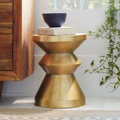 Brass sculptural side table
