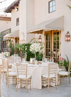 Tuscan-inspired ivory linens and champagne pinstriped napkins: http://www.stylemepretty.com/2016/09/13/white-navy-gold-wedding/ Photography: KT Merry - https://www.ktmerry.com/