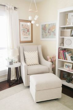 Don't need a nursery but I like this sitting area for family room, perfect reading nook and a big bookcase for all the kids books!