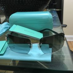 Authentic Tiffany's rimless sunglasses Brand new Tiffany & Co rimless sunglasses grayish lens every sharp looking Tiffany & Co. Accessories Glasses
