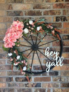 Spring wreath with pink hydrangeas on bicycle wheel