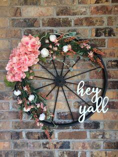 Spring wreath with pink hydrangeas on bicycle wheel Bicycle Wheel Decor, Bicycle Rims, Bike Wheels, Bicycle Art, Wagon Wheel, Bike Wagon, Outdoor Wreaths, Pink Hydrangea, Porch Decorating