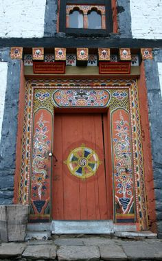 Many cultures use elaborate art work and bright colors to create a sense of well being and happiness as you enter the home. Bumtang Valley, Bhutan