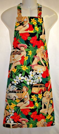 A fun Mans apron in an Alexander Henry screen print of alluring aloha retro pinup girls posing in swimsuits with Woodies, Hawaiian flowers and foliage. The girls stand approximately 8 to 11 inches high on a jet black background. The statuesque chanteuses are playing ukuleles, and nestled among tropical flora. These pictures do not do justice to the luscious colors of red, orange, bright green, yellow, brown, sand and black in this screen print. $33.50