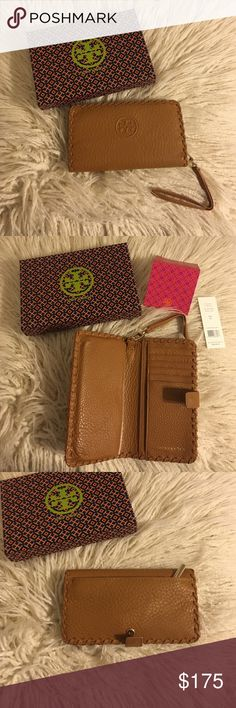 """SALE❗️Tory Burch Marion Smartphone BiFold Wristlet NWT Tory Burch Marion Smartphone Bifold Wristlet! It's the all-in-one for your mobile - it fits an iPhone 6 - and your cash and cards. Made of super-soft pebbled leather, it features plenty of pockets and compartments. Color is bark! 100% authentic  * Fold-over pin snap closure * Removable wriststrap * Fits an iPhone 5 and 6 * Length: 6.97""""  * Height: 3.98""""  No trades No lowballing ✅Bundle Discount  Authentic items  ✨purchase at listed…"""