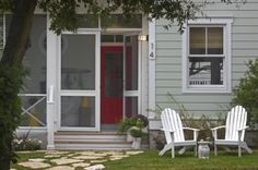 Beach house from Georgia featured this morning on Houzz.  Love the screened in porch and red door.