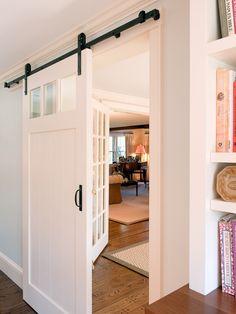 Image from http://www.dennisdanziger.com/wp-content/uploads/2015/04/wonderful-johnson-barn-door-hardware-wall-mounted-bookshelf-white-door-frames-laminated-wooden-floor-area-rug.jpg.