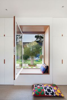 Everything in this image is amazing. From the leather pull handles in the joinery to the timber clad window seat framing the view to the garden and the feature tree. Design by Bower Architecture. Australian Interior Design, Interior Design Awards, Interior Styling, Architecture Awards, Interior Architecture, 1960s House, Chula, Windows And Doors, Home Renovation