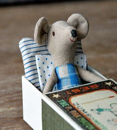 Build a matchbox bed  - Mr. Little had made Stuart Little a bed out of four clothespins and a cigarette box.
