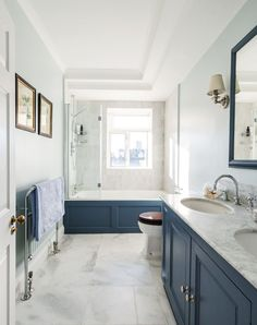 Mid Sized Transitional Master Tub Shower Combo Photo In London With Recessed Panel Cabinets Blue Cabinets A Drop In Tub White Tile Stone Tile Blue Walls Marble Floors An Undermount Sink And Marble Countertops