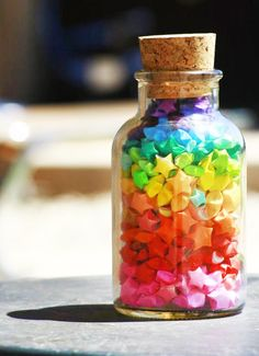 Make these Origami stars using coloured paper put them into glass bottles jars for a gift! Origami Stars, Origami Owl, Origami Paper, Rainbow Origami, Origami Lucky Star, Bottle Charms, Bottle Art, Rainbow Aesthetic, Taste The Rainbow