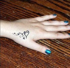 Hand Tribal Heart Tattoo