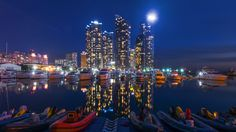 night city buildings and boats 4k ultra hd wallpaper