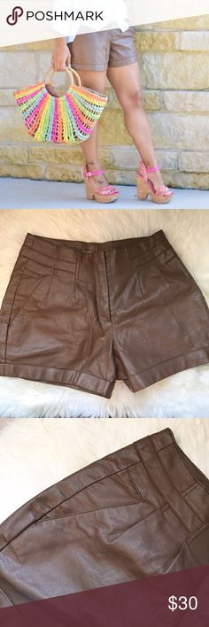 """Lauren Conrad Brown Faux Leather Shorts Pre loved shorts in excellent condition. Side pockets, center zipper, sits higher on waist. First picture taken for blog in outside lighting, other pictures taken inside which is why it appears darker. Waist is 15"""", length is 14"""" ❌NO TRADES OR PAYPAL❌ LC Lauren Conrad Shorts"""